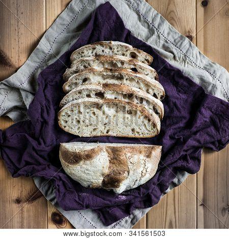White Flour Warm Spot Levain Bread On A Rustic Table