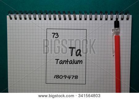 Tantalum - Ta. Write On A Book Isolated On Office Desk