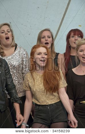 Singers from University of Exeter Soul Choir perform live on the Global Community Stage