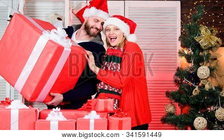Preparing Presents For Christmas. New Year Gift. Gift From Santa Claus. Man And Woman With Gift Boxe