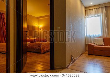 Hotel Room Interior. Modern Hotel. Seaside Resort. Bedroom Interior. Cozy Bedroom. Big Double Bed. B