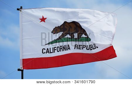 State Flag Of United States Of America California Fluttering In The Wind Of The Blue Sky Which It Wa