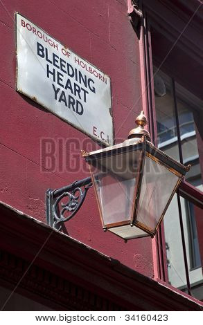 The street sign for Bleeding Heart Yard in London. Bleeding Hart Yard was immortalised in Charles Dickens' novel 'Little Dorrit. poster