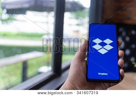 Chiang Mai, Thailand - Aug.24,2019: Man Holding Xiaomi Mi Mix 3 With Dropbox On Screen. Dropbox Is A