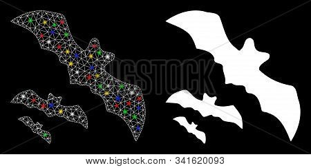 Flare Mesh Flying Bats Icon With Sparkle Effect. Abstract Illuminated Model Of Flying Bats. Shiny Wi