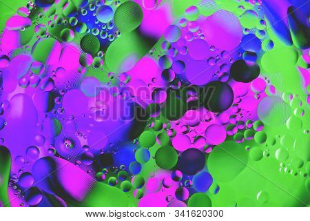 Background From Multi-colored Small Balls Of Heterogeneous Coloring, Mainly Blue, Interspersed With