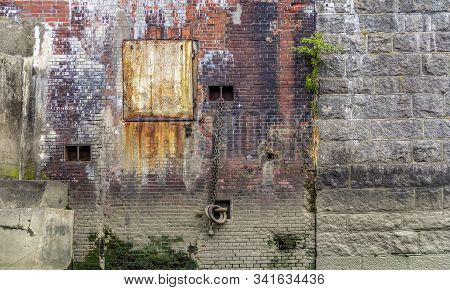 Rundown Weathered Quai Wall Seen At The Port Of Hamburg