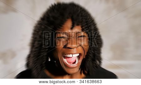 Eal Afro American Lady With Fleecy Hair Screams In Anger And Cries Against White Wall, Radial Blur