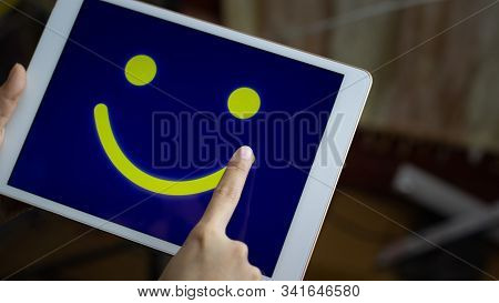 Conceptual The Customer Responded To The Survey. The Client Using Hand Drawing  Smile Face On Screen