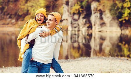 Happy Fashionable Couple Having Fun Together Outdoors. Love, Relationship And Fashion Concept. Beaut
