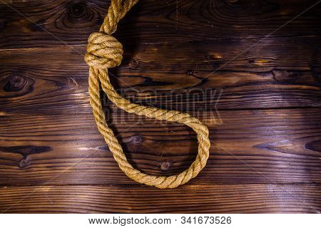 Rope With Noose For Suicide On Wooden Background