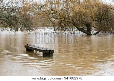 A Bench Becomes Part Of The River Mole In Brockham, Surrey, Uk, As Heavy Rain Caused Flooding In Sur