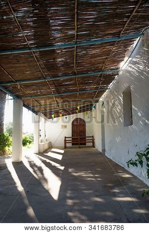 Entrance Of Abadoned Church Ermita De Sant Antoni Y Sant Jaume Veritcl In Cap Blanche With Dramatic