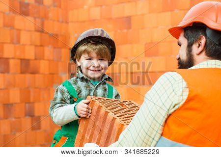 Kid Dressed Like Workman. Happy Child Boy. Labor. Fathers Profession For Son. Education And Experien