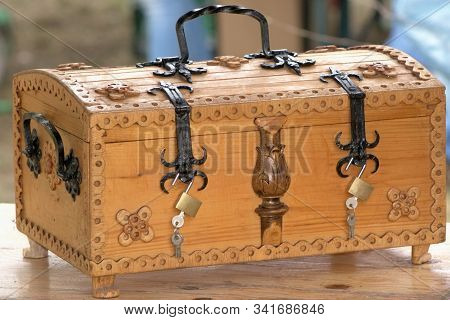 Grocery Crate Adorned With Fretwork And Wrought Iron Handle And Band