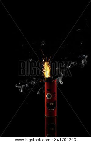 A Stock Photo Of A Red Sparkling Lighter With Sparkles And White Smoke Isolated On Black Background.