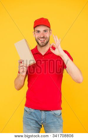 Giving Perfect Service. Courier Delivery. Postman Worker. Man Red Cap Yellow Background. Transportat