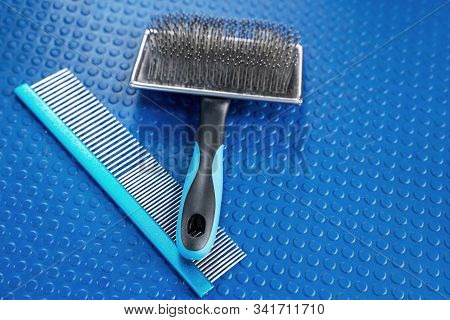 Close Up Grooming Brush And Special Professional Comb For Dog And Cat Grooming. Bright Blue Rubber M