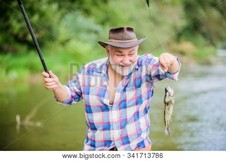 Young At Heart. Sport Activity And Hobby. Trout Bait. Summer Weekend. Fisherman With Fishing Rod. Re