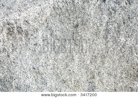 Rough granite stone surface useful for background or texture poster