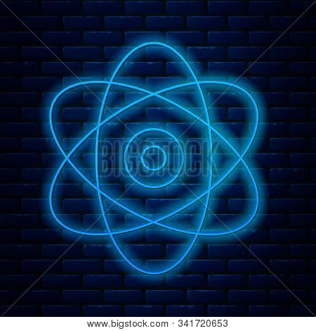 Glowing Neon Line Atom Icon Isolated On Brick Wall Background. Symbol Of Science, Education, Nuclear