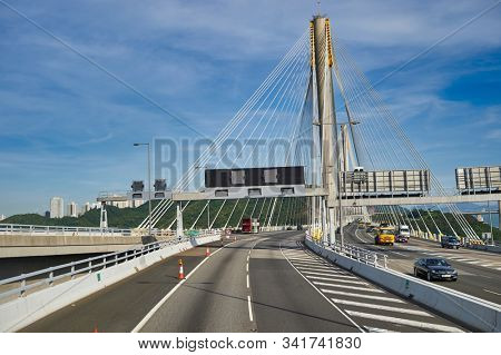 HONG KONG, CHINA - JUNE 18, 2015: Ting Kau Bridge seen from second desk of a double decker bus in Hong Kong in the daytime. Ting Kau Bridge is a long cable-stayed bridge in Hong Kong.
