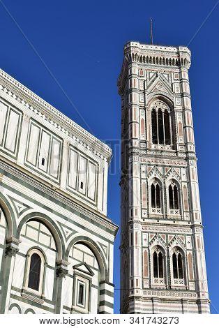 Campanile Di Giotto And Battistero Di San Giovanni From Piazza Del Duomo With Blue Sky. Florence, It