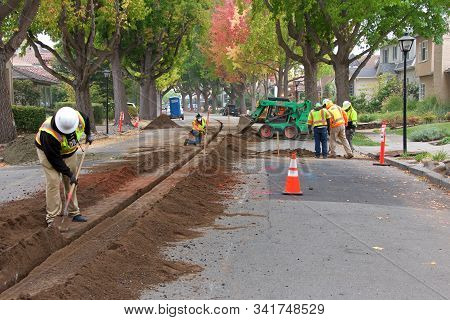 Alameda, Ca - Nov 07, 2019: Crews Cutting A Ditch In The Middle Of A Residential Street To Undergrou