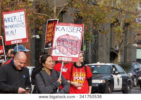 Oakland, Ca - Dec 17, 2019: Unidentified Health Care Workers Protesting Marching Down Broadway To On