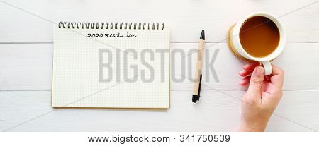 2020 Resolution On Blank Notebook Paper On White Wood Background, 2020 New Year Banner, Mock Up, Tem