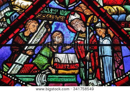 Bourges, France - november 26 2017: Bourges cathedral stained glass - The invention of the relics of St Stephen - Lucianus finds the tomb of St Stephen
