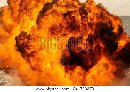 Massive Fire Explosion Close Up In Military Combat And War. Vehicle Explosure From A Tank In A City