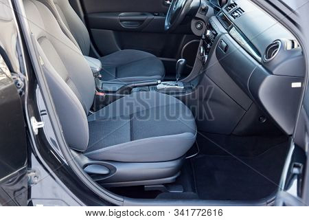 Comfortable Front Seats Inside The Car: The Driver And Passenger, Tied With Genuine Black Leather, M