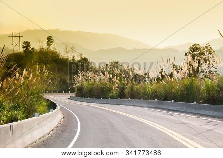 Sunset On Curve Road In The Mountain And Forest, Country Road Of Nan In North Of Thailand