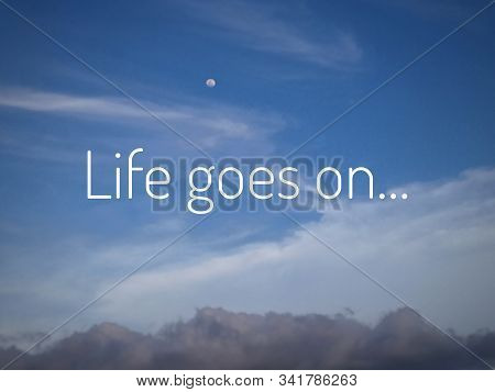 Inspirational Motivational Quote - Life Goes On. With Simple Text Messages Design Written On Bright