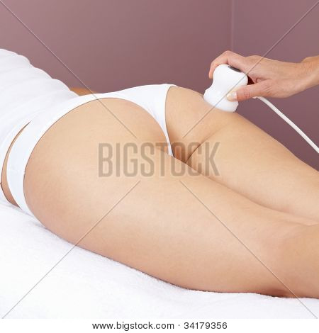 Woman getting electrical massage for muscle stimulation at buttocks