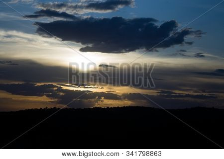 Sunset Sky With Red Clouds Over The Mountains
