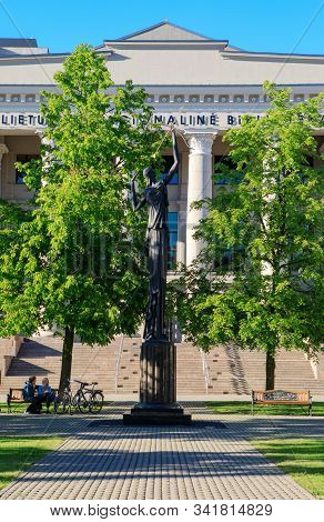 Vilnius, Lithuania - May 7, 2018: People With Their Bikes Have A Rest In Front Of The Lithuanian Nat