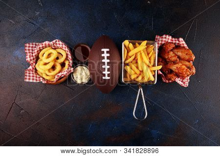 Chicken Wings, Fries And Onion Rings For Football On A Table. Great For Bowl Game Party