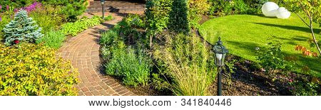 Landscaping In Nice Green Garden In Summer. Panoramic View Of Landscaped Place At Residential House.
