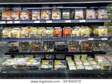 Emeryville, Ca - Oct 31, 2019: Grocery Store Refrigerator Aisle With Containers Of Pre-packaged Wrap