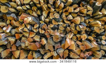 Firewood Chopped And Stacked For The Winter. Closeup Image Of Chopped And Stacked Firewood In Prepar