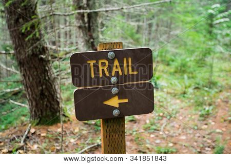 Hking Trail Sign With Direction Arrow Pointing Left