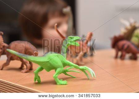 Dinosaur Toy. Boy Having Fun Playing With A Toy Dinosaur, Selective Focus