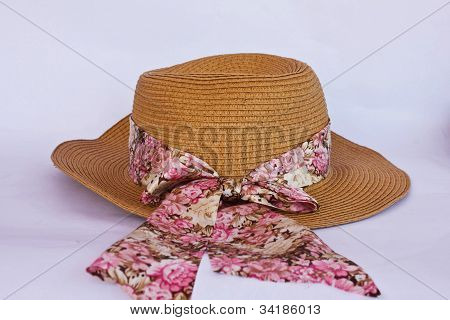 A Straw Hat With A Ribbon