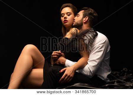 Seductive Couple Of Lovers Playing With Feather On Bed In Dark Room