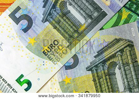 2 Banknotes Of 5 Euros Are On The Background Of 100 And 50 Euros. Inflation Concept