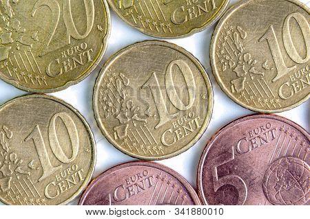 Background Of Euro Cents. Macro. Closeup. Background Made Of Euro Money. Small Money. 5 Euro Cents.