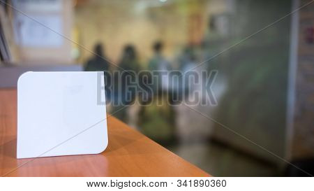 Blank Flayer To Complete By Adding Brand, Phrase, Text. Unfocused Meeting Room Background With Peopl