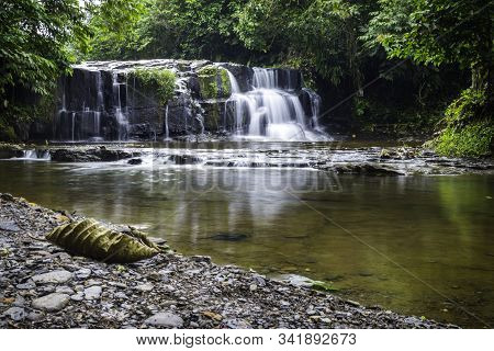 Yanayacu Waterfall In Amazonian Jungle, Covered With Vegetation. Amazon Rainforest, Ecuador